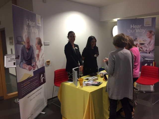 Photo of delegates at Cochlear stand